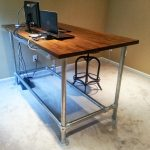 awesome wooden homemade standing desk design with metal legs and computer set in room with concrete floor and cream wall