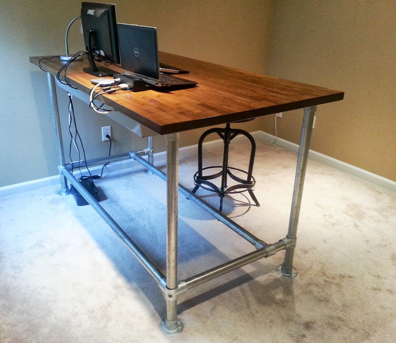 awesome wooden homemade standing desk design with metal legs and computer set in room with concrete