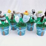 baby boy shower centerpieces for tables with sock or baby clothes plus blue pot