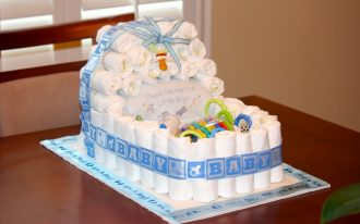 baby boy shower decorations for tables with diaper cake ideas and cute blue ribbon