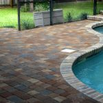 brick paver calculator with stacked bond pattern aside with curved pool and fresh garden