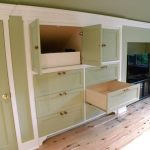 built in drawers and cabinets with big shelf for putting TV console