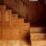built in drawers under the staircase made from wooden