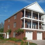 Charleston Style House Plans With Brick Wall And Two Car Garage Door Plus Balcony And Garden