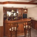 classic and small wine bar design with two barstools two pendant lamps in classic style wine shelves