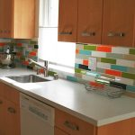 colorful backsplash tiles design for small kitchen wooden kitchen cabinetry white kitchen countertop sink and faucet
