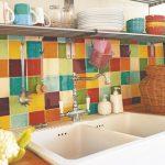 colorful kitchen backsplash tiling idea double sinks and single faucet single metal floating shelf for organizing dishware drink glasses cups bowls