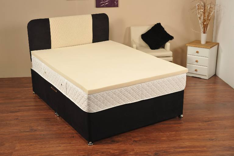 cooling mattress pad for tempurpedic with comfy topper and white armchair and wooden nightstand and vase