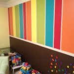 creative wall interior idea with washable paint for wall in colorful style in play room with plenty of toys