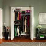 easy closet organization ideas for small closet with doors and wooden floor plus rug and black side table and umbrella storage