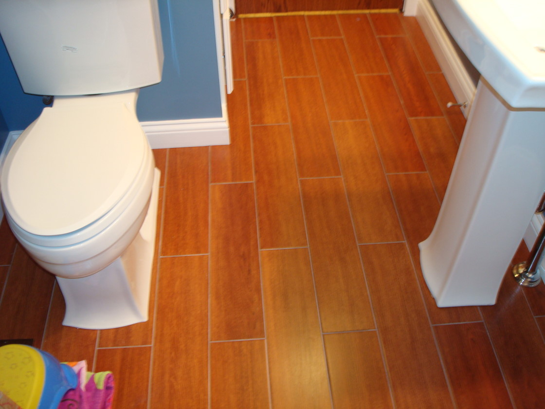 Eco Friendly Cork Floor In Bathroom In Brown Finish With Toilet And Sink