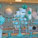 elegant baby boy shower centerpieces for tables in blue theme with cake and cupcake