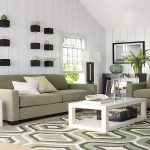 elegant sofas and decorative pillows white coffee table  dark brown basket storage underneath modern patterns rug white side table idea floating plant boxes in black