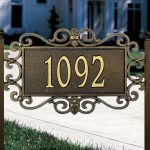 elegant vintage address plaques for home design with carved style stacked on two poles above grassy meadow with 1092 number