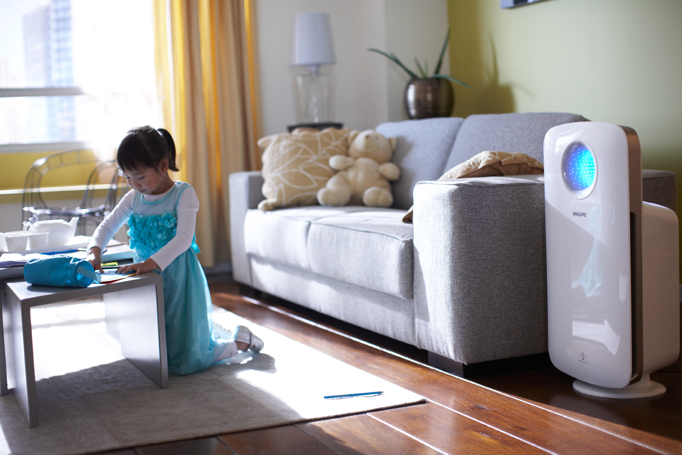 elegant white air purifiers for smoker with slim model aside white sofe on wooden floor with kid friendly coffee table