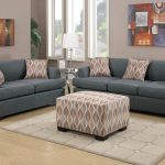 furniture shipping quote gray sofa in living room decorated with ottoman coffee table and modern rug on wooden laminate floor and metal end table and table lamp