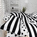 gorgeous black and white combination of modern pattern with stripe accent and polka dot pattern on the surface in industrial bedroom design with white brick wall and ladder storage