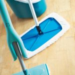 gorgeous creamy hardwood floor design with blue mop with long stick for best thing to clean hardwood floor