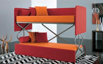 gorgeous red and orange couch that turn into bed design with pillows on chevron patterned area rug in gray room
