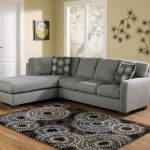 grey affordable sectional couches with cushion and patterned rug on woooden floor and cool wall art with dandelion
