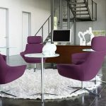 haworth very task chair in purple decorated with round metal table and white round rug plus wooden computer desk and mirror on wall