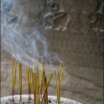 how to get rid of smoke smell in house with joss stick stacked on round place with sand aside rustic wall with relief