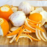how to get rid of smoke smell with orange peel on wooden board bathed in natural scent with knive and oranges