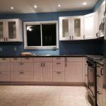 ikea assembly service nyc for kitchen with white wooden cabinets and black countertop and tile flooring and modern kitchen appliances