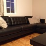 ikea assembly service nyc for living room with dark leather sectional sofa and wooden table plus cushion