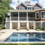 inspiring charleston style house plans with brick wall and rectangle pool and lounge pool chairs and outdoor kitchen and garden