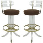 lucite acrylic counter stools in modern design and brown seating feature plus clear back