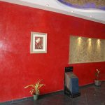 luxurious red washable paint for wall idea with photo gallery with file storage and potted plant and concrete top