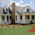 luxurious white colonial southern living house plans with picture design with brick chimney and ground walkway and large grassy meadow