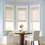 martha stewart window treatments with white roman shades and banquette seatinf ideas with wooden bench and cushions plus white chair and round oak table
