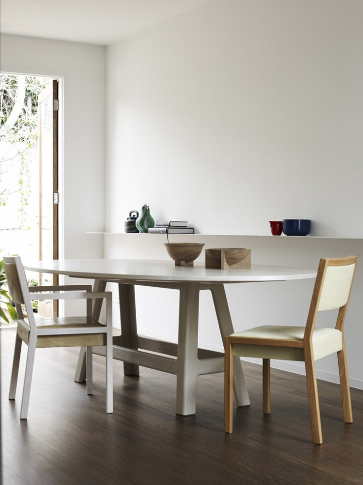 Modern And Classy Dinning Room Design With Two Vintage Chair Design And  White Round Table From