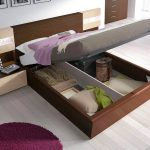 modern apartment storage bed nyc design with brown wooden platform and gray bedding with minimal nightstand and purple round rug