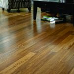 modern brown most durable hardwood floor design with black wooden furniture and zebra patterned sofa idea