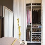 modern california closets nyc reviews in bedroom with curtain and shoes storage and hanging rod and large mirror