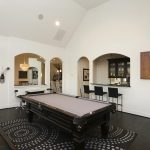 modern game room ideas for adult plus pool or billiard table and black leather sofa and rug plus dark wooden floor and black bar stool