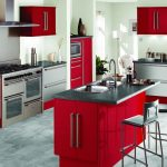 modern kitchen red kitchen island with  grey granite counter plus double sinks and faucet two barstools metal kitchen cabinet underneath red top cabinets kitchen appliances