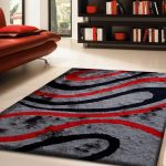 modern red black and gray area rugs decorated in living room with orange leather sofa and wooden bookcase and white floor
