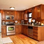 most popular hardwood floor colors for kitchen with traditional wooden cabinets and modern kitchen appliances plus granite countertops