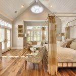 most popular hardwood floor colors for stunning bedroom ideas with canopy bed and vintage sideboard and comfy chairs and fan on wooden ceiling