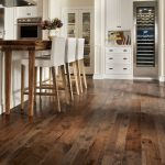 most popular hardwood floor colors in rustic kitchen ideas with white cabinets and sliding rack plus kitchen island with comfy white chair
