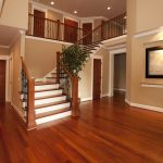 most popular hardwood floor colors together with awesome staircase and wooden door plus natural brown wall for awesome entryway