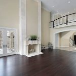 most popular hardwood floor colors with classy fireplace and glass door plus chairs and candle holder plus greenery