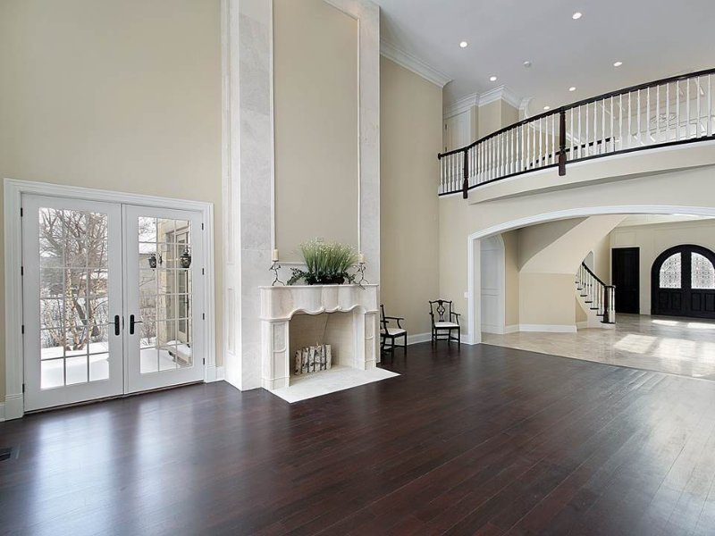 most popular hardwood floor colors with classy fireplace and glass door plus chairs and candle holder - Dark Hardwood Hotel 2015