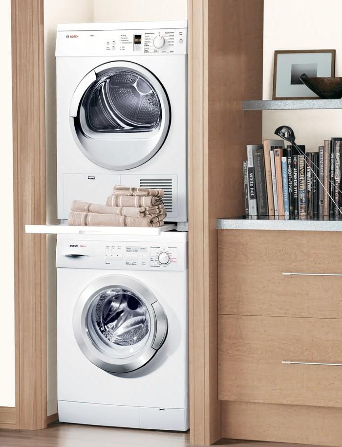 Natural Beige Smallest Stackable Washer Dryer Design With Bookshelves Aside On Glossy Wooden Floor Recessed Simple Laundry Room