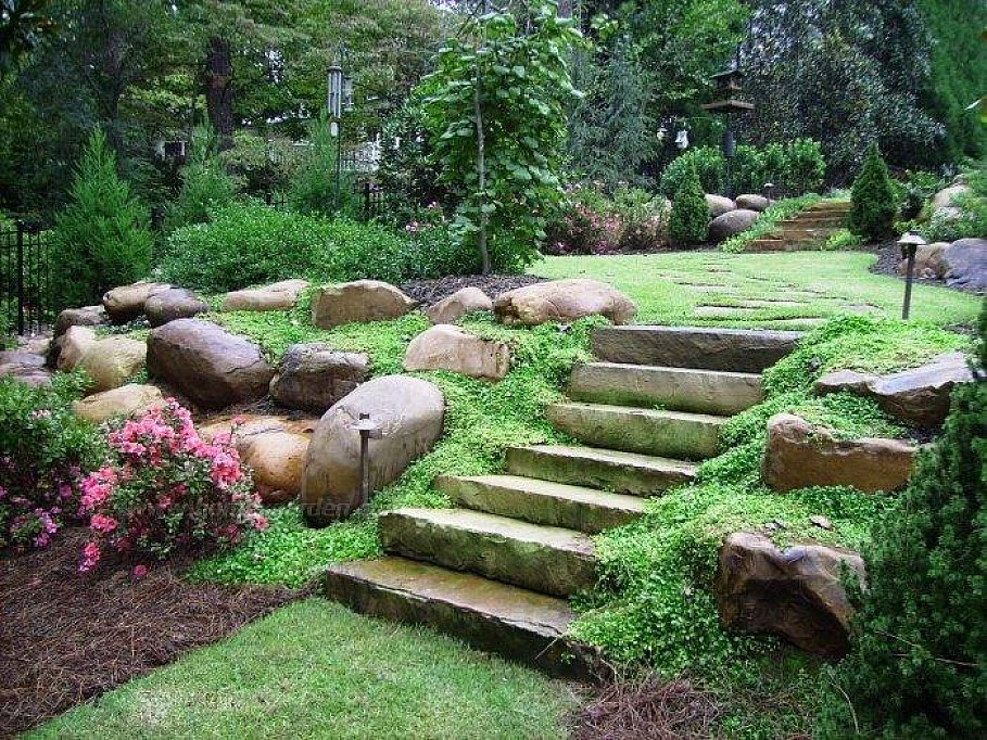 Natural Landscaping Ideas For Front Of House And With Rock Metal Fence Plus Garden Light