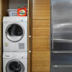 natural wooden laundry room design with stainless storage idea aside small stackable washer dryer combo idea beneath linen storage